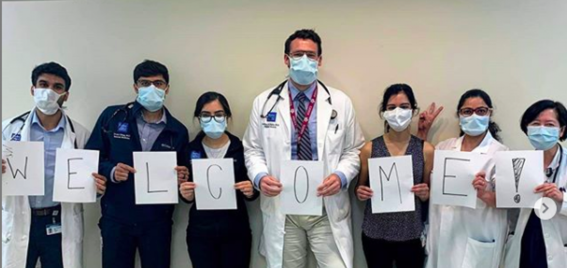 Internal Medicine residents holding a welcome sign