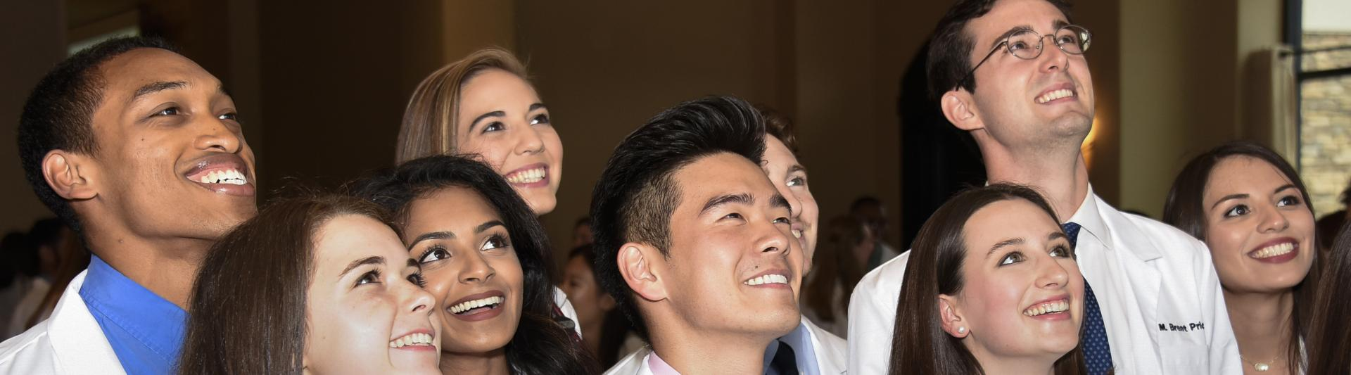 Students celebrating at their White Coat Ceremony