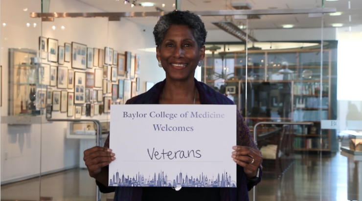"Dr. Alicia D.H. Monroe, senior vice president and provost, holding a ""Baylor College of Medicine Welcomes Veterans"" sign for Diversity and Inclusion Week video"