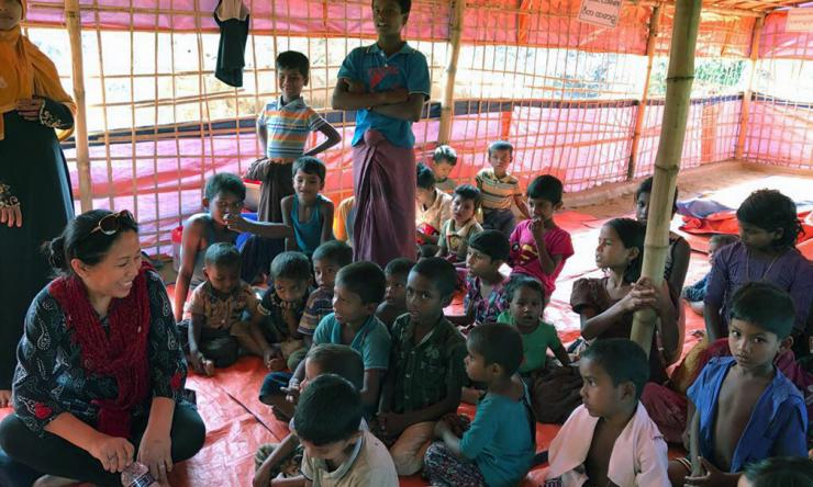 BCM volunteers working with a group of children.