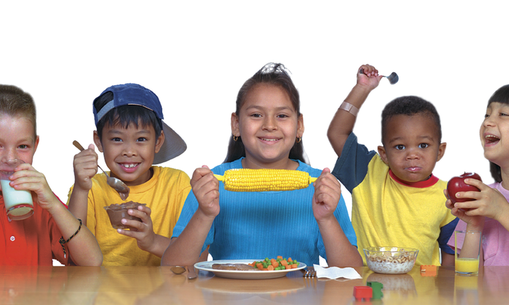 A group of children eating healthy food.