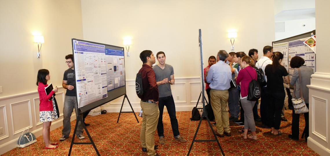 Students, postdocs and faculty during a poster presentation session