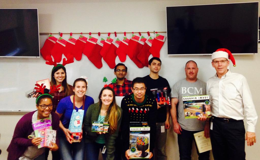 2016 Holiday White Elephant Party: showing off gifts (some stolen more than once).