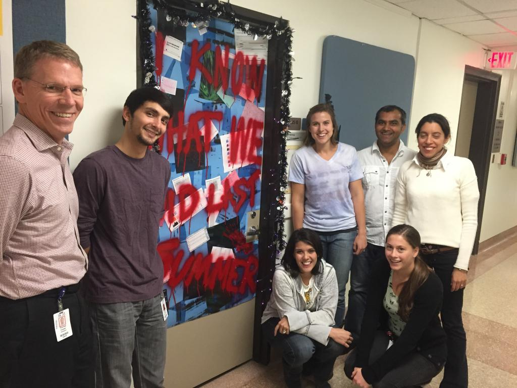 Winners of the Halloween door contest and pizza for the lab