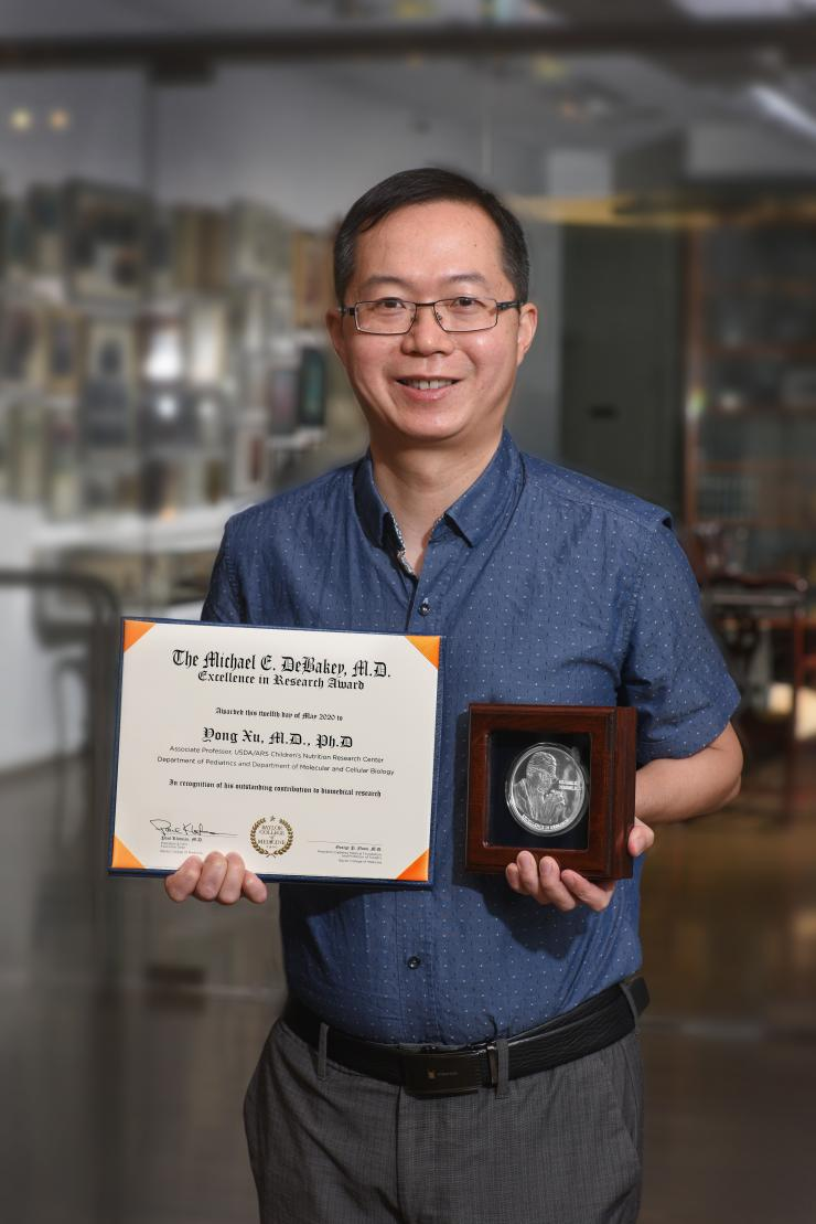 Yong Xu, M.D., Ph.D.