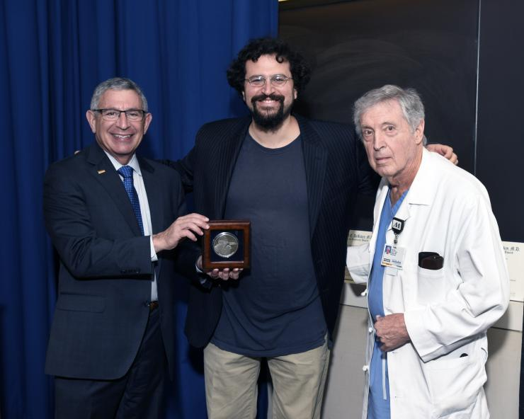 Dr. Lieberman with Drs. Klotman and accepts the 2018 DeBakey award.