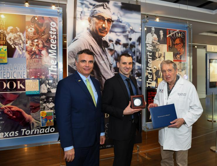 Dr. Marco Sardiello (middle) with Drs. Adam Kuspa (left) and George Noon (right).