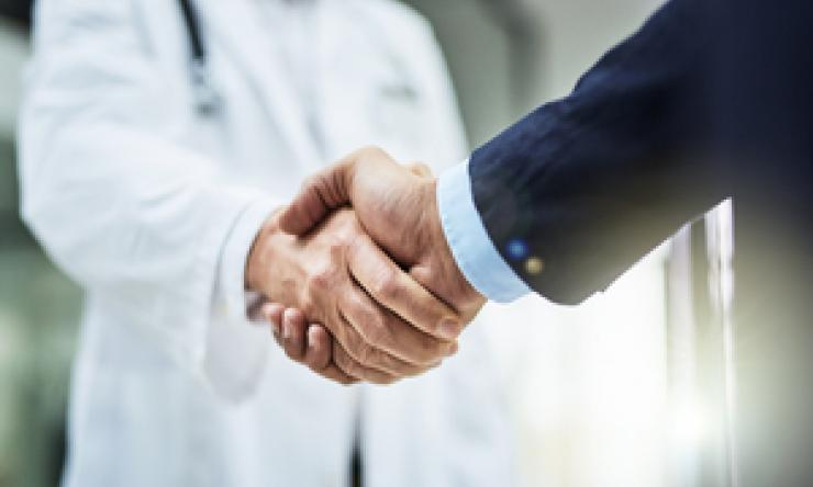 Hand Shaking with Doctor